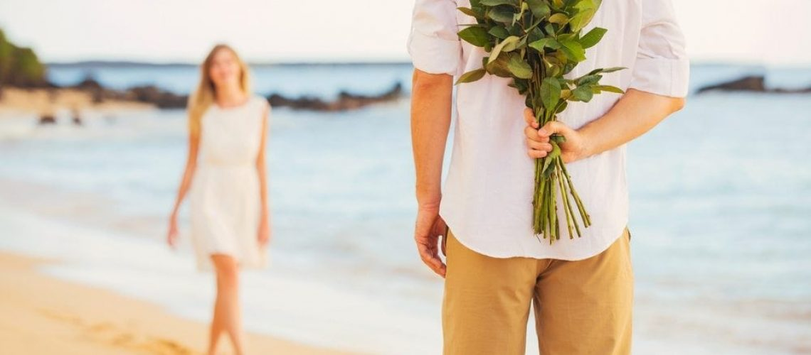 Man Holding Roses to Propose