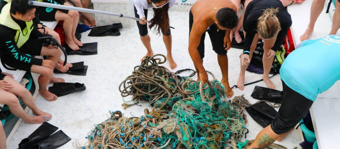 Dolphins and You crew removes trash from the ocean